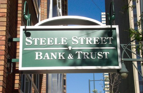 Steele Street Bank and Trust Flag Mounted Sign