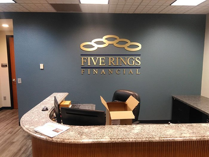 Reception Area Signs for Five Rings Made From Gold Aluminum