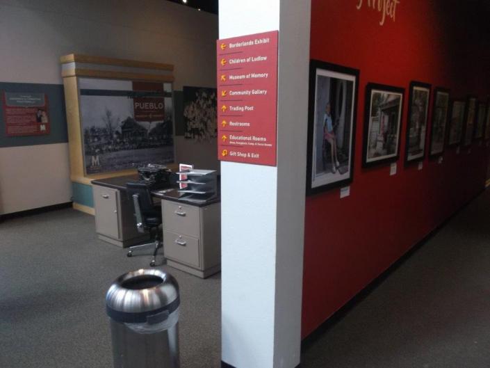 Interior wayfinding signage directory at El Pueblo History Museum.